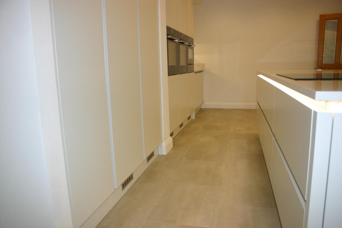 Large New kitchen featuring Karndean flooring