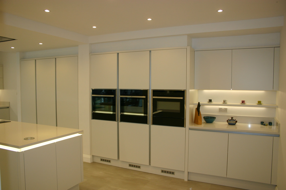 Large New kitchen featuring triple oven system