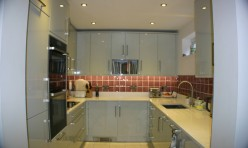 Gloss slab Kitchen in Gloss Grey