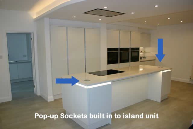 Pop-up Sockets built in to island unit