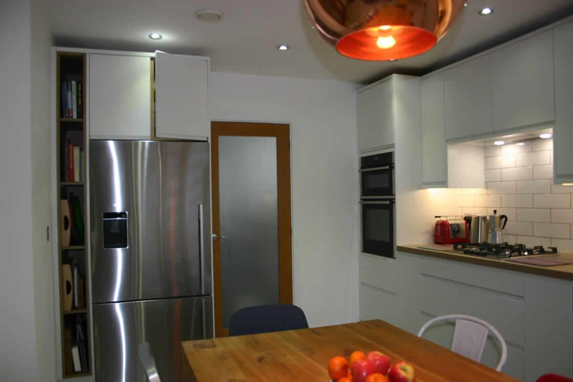 White Handle-less Kitchen Installation in Redhill Surrey