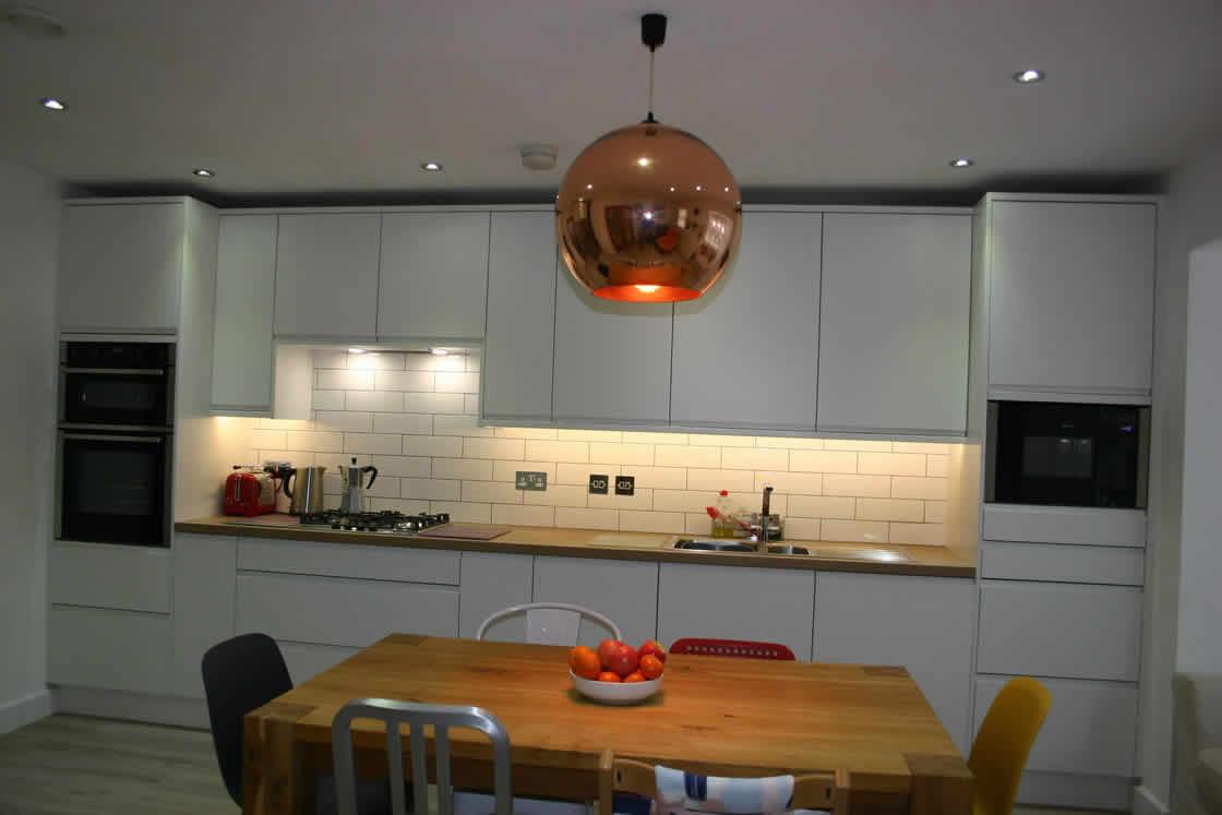 White J-Pull Handle-less Kitchen Installation