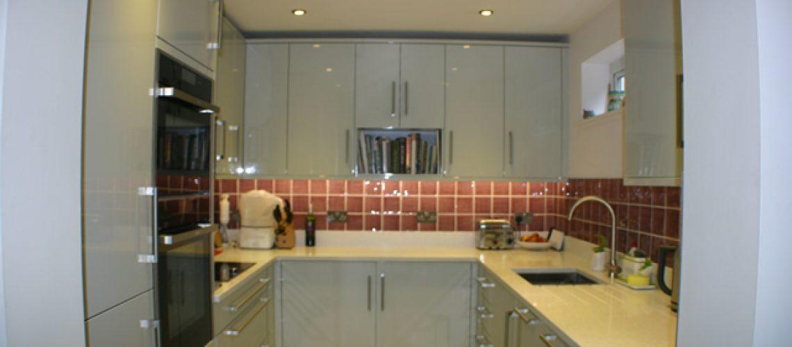 Gloss slab Kitchen in Gloss Grey