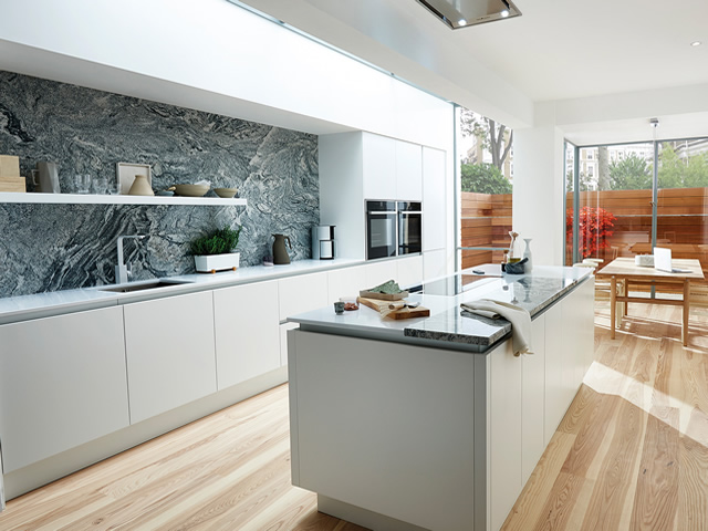 White Matt Handle-less Kitchen Featuring Marble Splashback