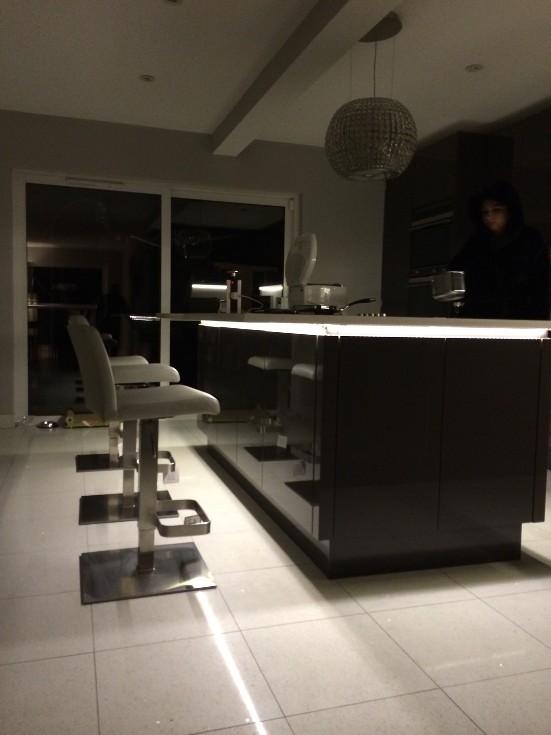 Handles-less Kitchen View of LED Light Strips on Island in Dark