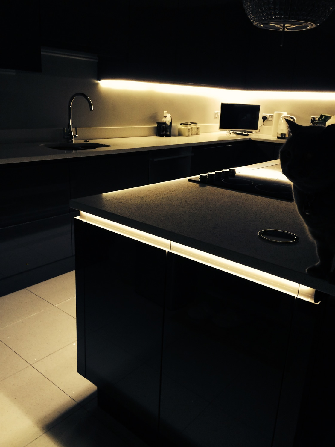 Handles-less Kitchen View of Lighting in the Dark