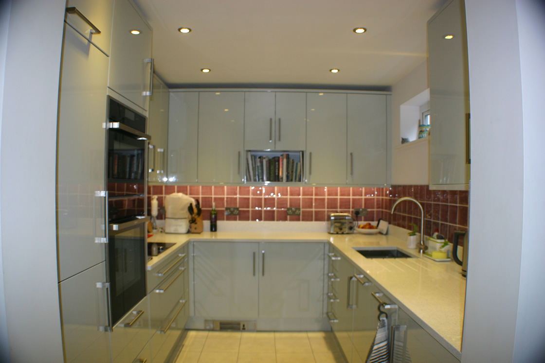 Large Gloss slab Kitchen in Gloss Grey