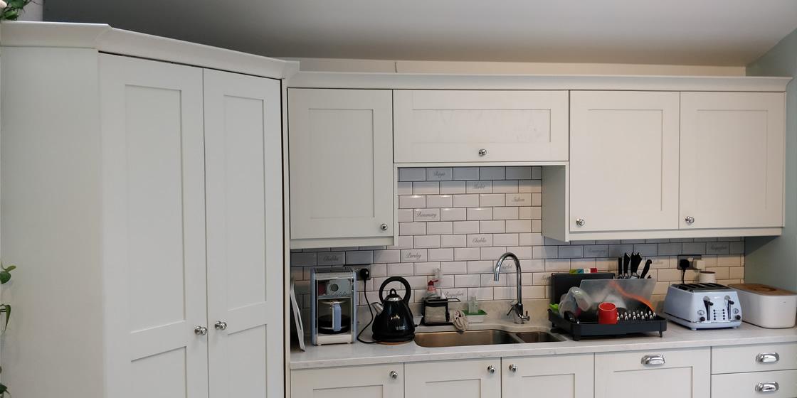 Shaker Ash Woodgrain Ivory Cupboards