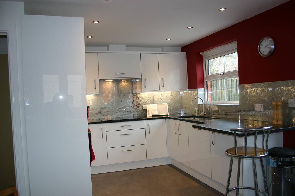 Bespoke High Gloss Acrylic White Kitchen Installation with Glass Splashback