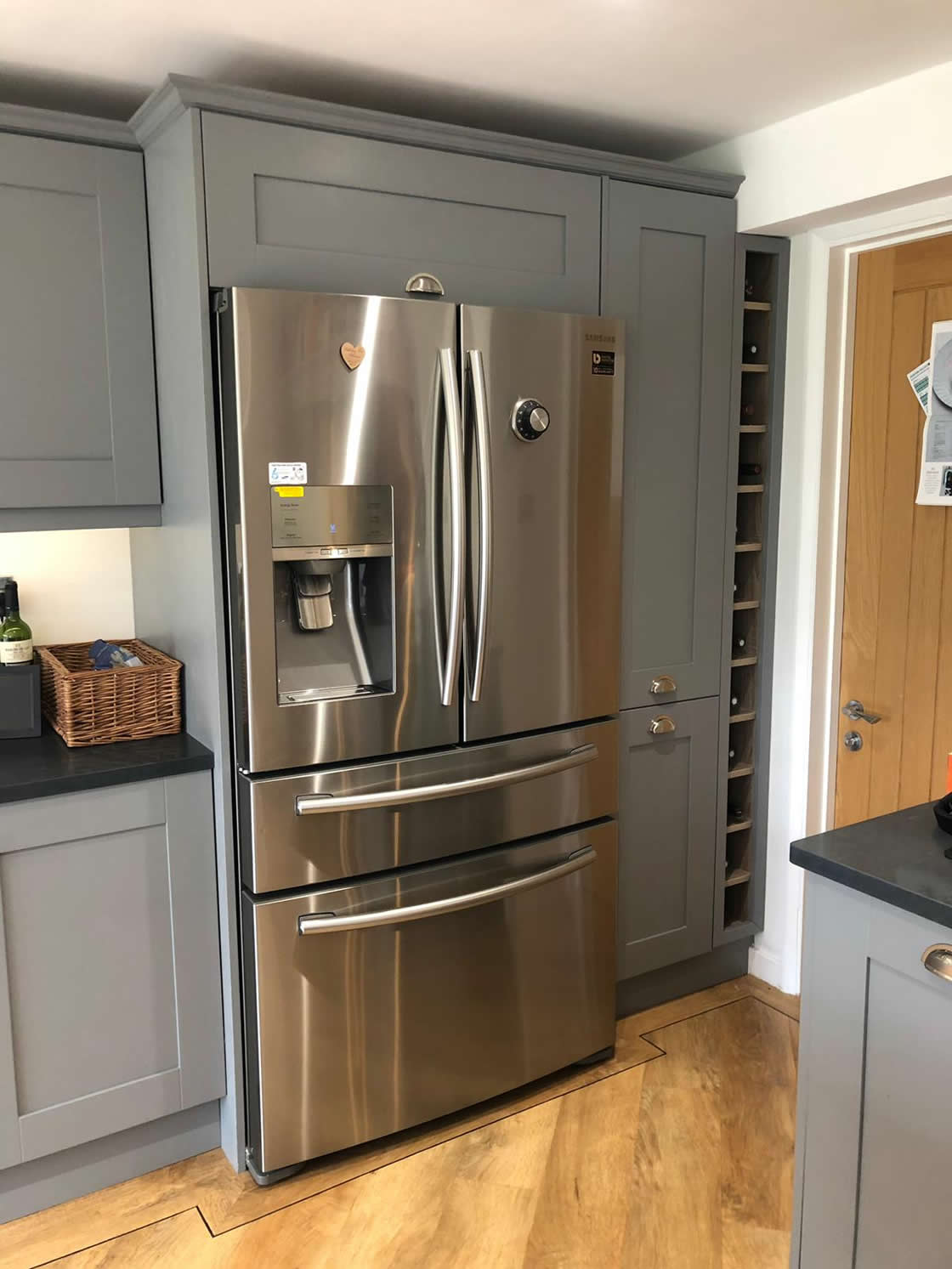 Large Silver Fridge in Custom Kitchen Installation