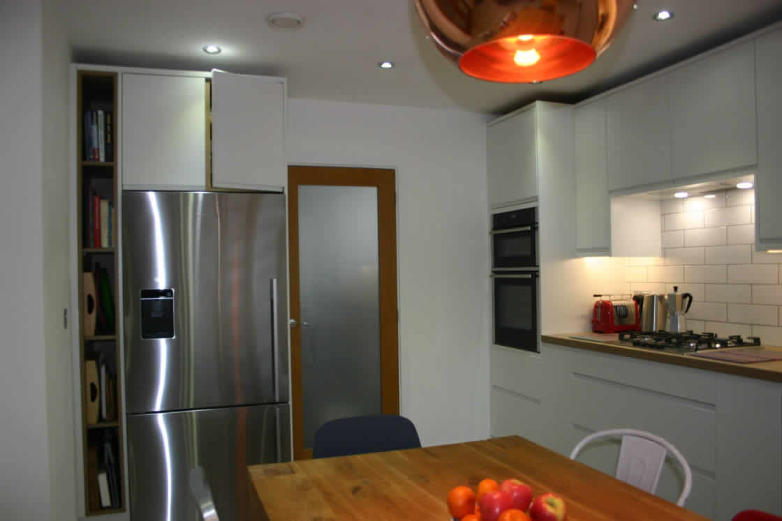 White Handle-less Kitchen Installation in Redhill Surrey