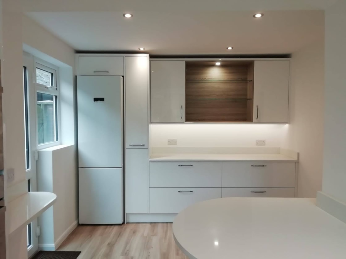 White Gloss Kitchen with Walnut Detailing