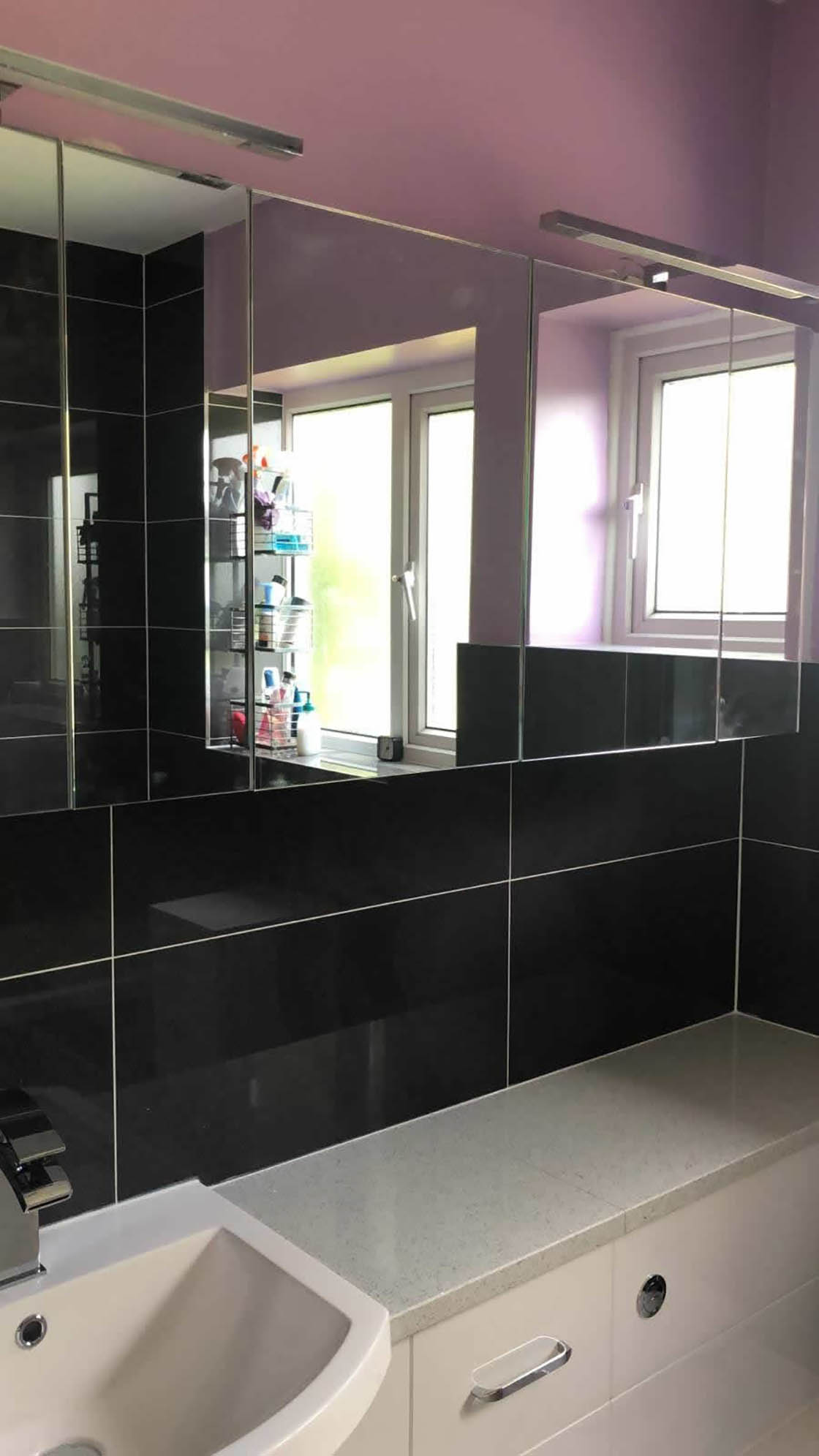 Compact Bathroom with Black Tiles