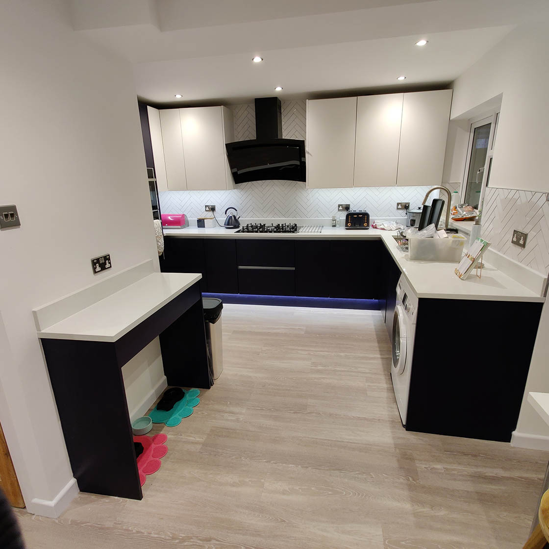 Blue and White Handle-less Kitchen in Redhill Surrey - Brooklands