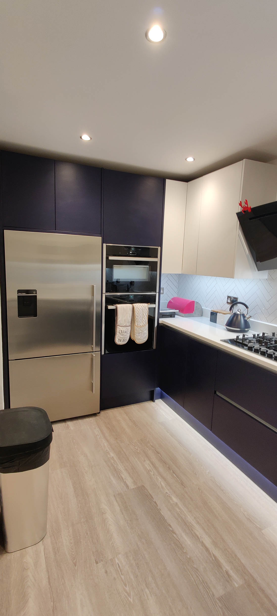 Handle-less Kitchen Showing Large Fridge and Double Oven - Brooklands