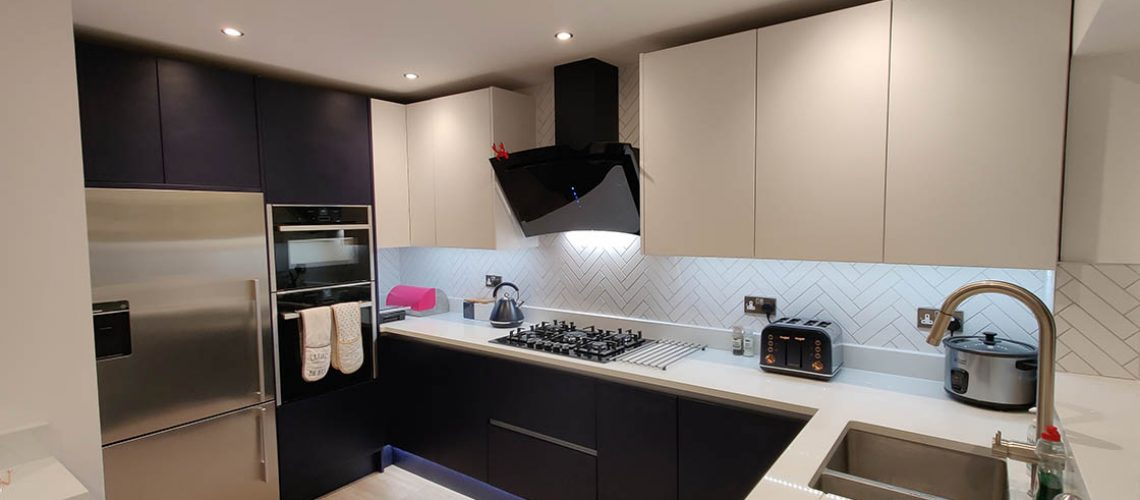 Handle-less Blue and White Kitchen Showing Range Cooker - Brooklands
